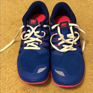 Nike Free 5.0 - NEVER worn. Kids 7y or women's 8.5